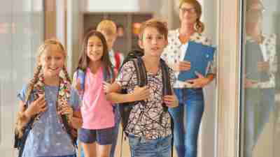 ADHD Pupils and teacher walking across the corridor