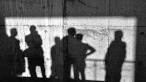 People with ADHD cast shadows on the concrete wall