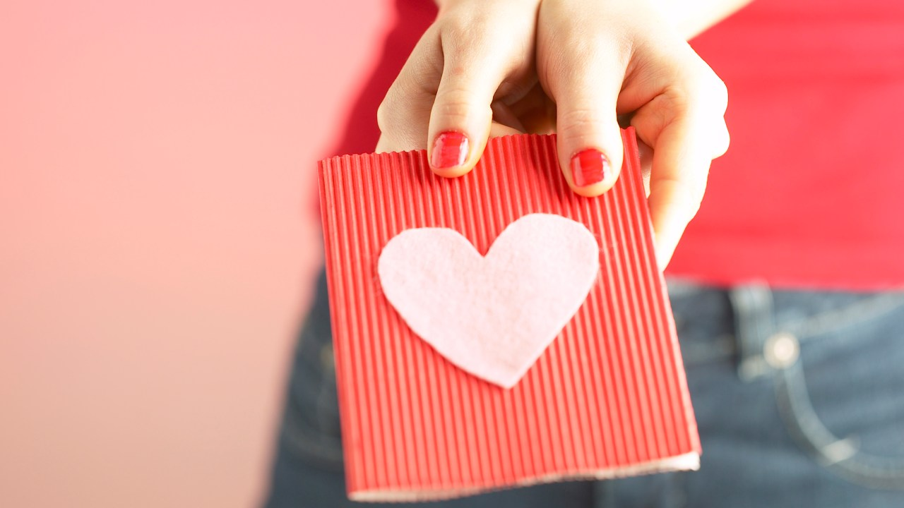 ADHD woman giving a card with a heart