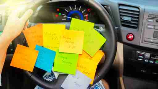 13 Survival Strategies for Moms with ADHD- driving wheel with reminder stickies