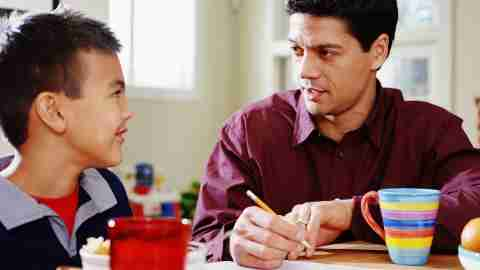 Father and son discussing homework problems together