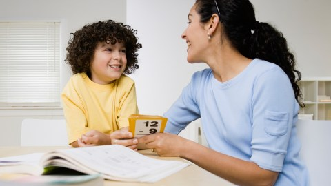 Mother and son talking happily about his progress on his homework problems