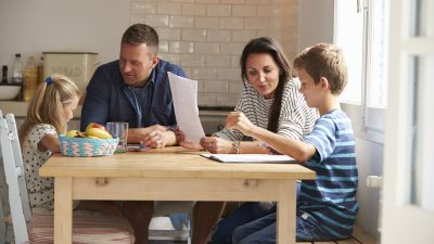 Parents discussing examples of behavior therapy with their two children