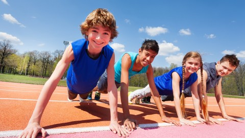 Teens exercising outdoors to improve their behavior in the classroom