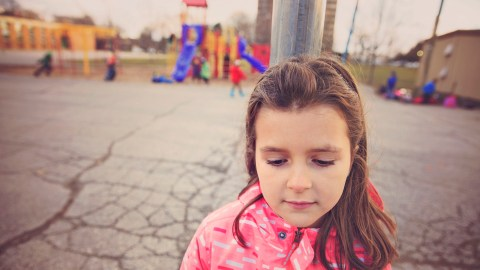 A girl with ADHD has trouble making friends at recess because of her behavior.