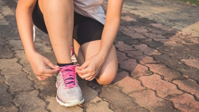 A woman prepares to go running to outsmart the link between ADHD and obesity.