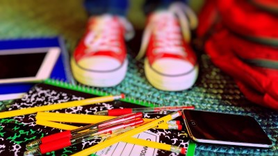 An ADHD student stares down at school supplies on the floor.