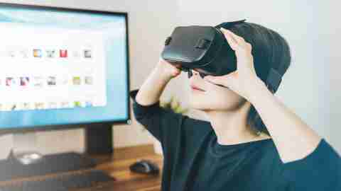 A teen with ADHD plays video games with a virtual reality headset