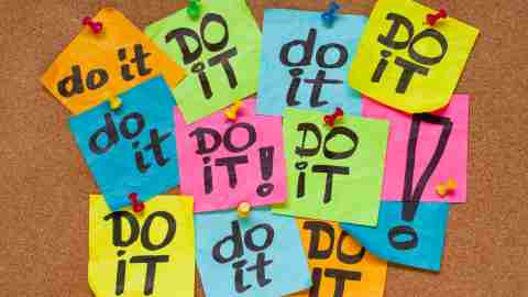 "Post-its that say ""DO IT!"" to represent one of the best ADHD podcasts on productivity"