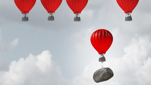 Hot air balloons, one tied to a rock, representing self-defeating behaviors in one of the best ADHD podcasts