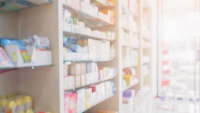 A blurred image of a pharmacy where stimlants and ADHD medication are sold.