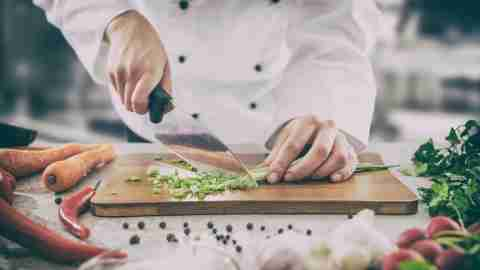A chef cutting onions after finding the right job