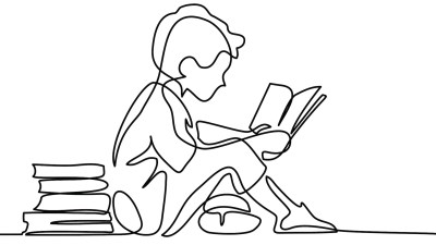 A boy reading, outlined in black and white. Building reading skills at home.