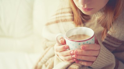 """A teen girl doing the """"hot chocolate breath,"""" a mindfulness exercise designed for teens"""