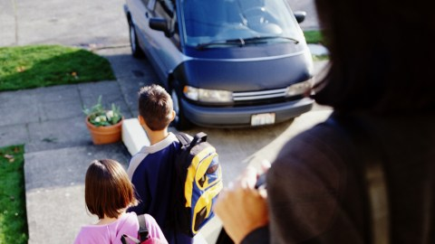 A mom with ADD watches her kids go to the car