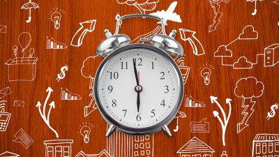 An alarm clock on an illustrated background, represents our sense of time passing