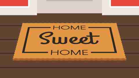 A home sweet home mat in front of a door, as seen by someone going back to work after vacation