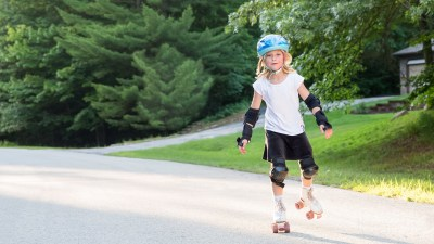 A girl with ADHD roller skates on her summer vacation.