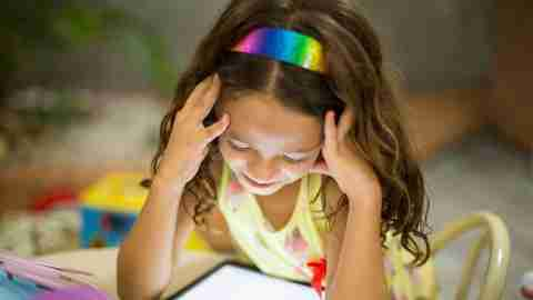 a child watches a video to learn cooperation skills