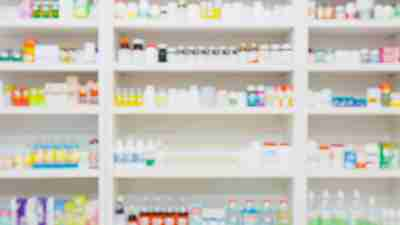 medicines arranged on shelves in the pharmacy blurred background
