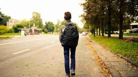 Kid walking alone
