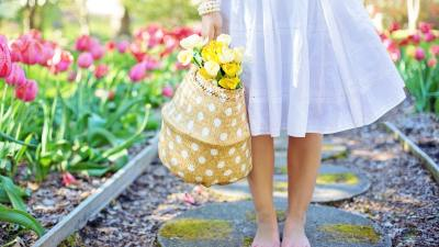 Barefoot woman with flowers