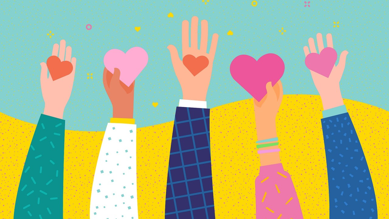 An illustration of hands holding hearts symbolizes loving someone with ADHD.