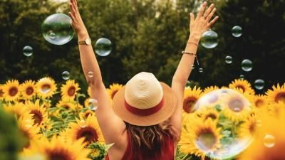 Woman with ADHD in a field of sunflowers