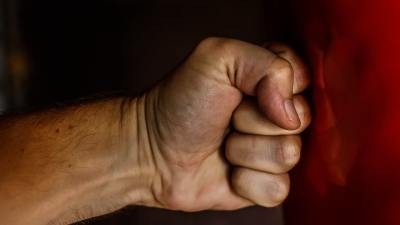 Angry fist hitting a wall