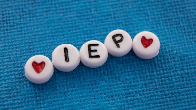 Special education Individualized Education Plan acronym IEP beads on canvas
