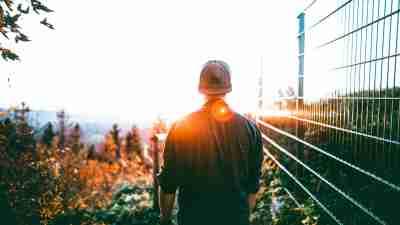 I Feel Stupid - teen boy with ADHD walks along a fence