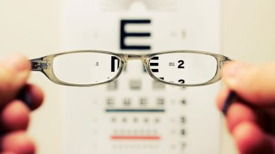 vision chart and pair of eye glasses