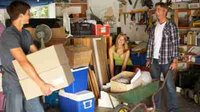 How to get organized: A family clearing out a garage together