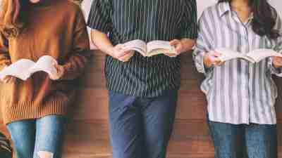 teens holding books