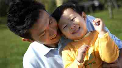 Asian father and young son