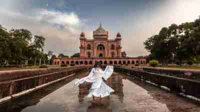 Indian woman dancing in water in Delhi