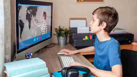 A student video conferencing with a teacher.