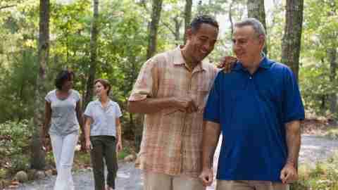 Friends walking in forest