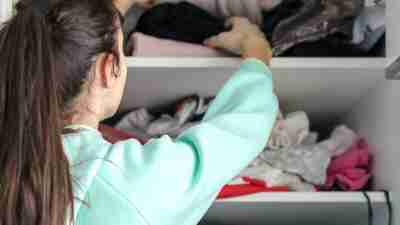 Teen taking things from her bedroom wardrobe