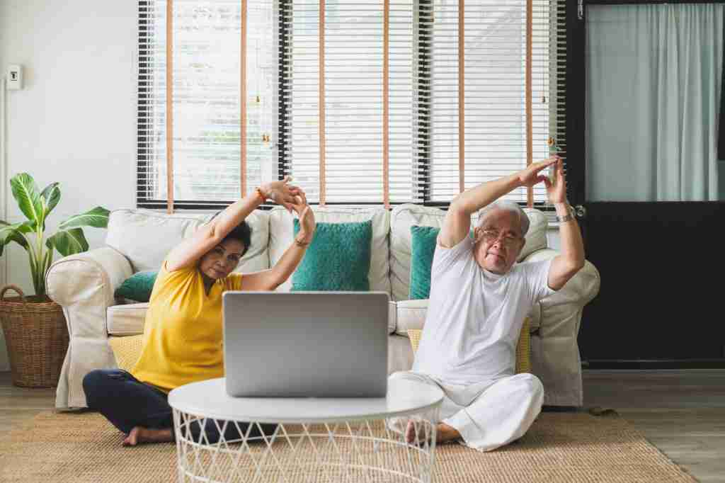 Asian old senior workout exercise and doing yoga at home
