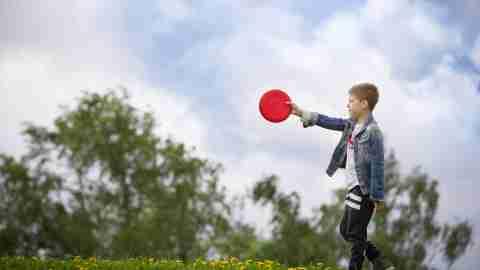 Boy holding a frisbee