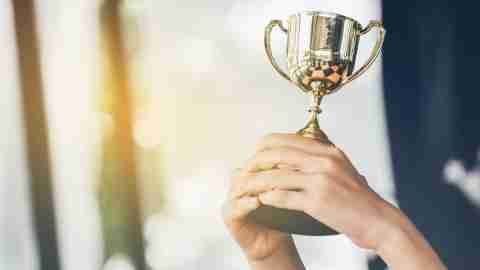 adhd Teenage girls' hands are holding trophies, congratulations on success.Conception of victory in the competition.