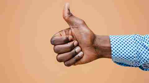 adhd adult Hand showing OK sign isolated on brown background