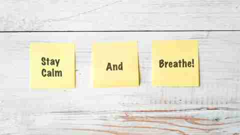 Three Yellow Post It notes with Message Stay Calm and Breathe for adhd overwhelmed parents