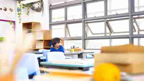 add symptoms - child looking out the window in a classroom