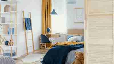 unmade bed in kid's bedroom