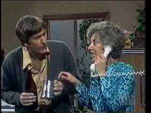 Photo from You Tube. Ross Higgins as Ted and Judi Farr as his poor long suffering wife Thelma.