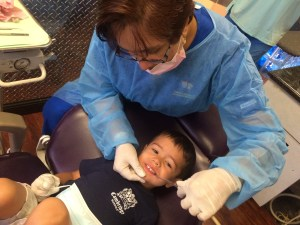 Dental Technician working on young boy