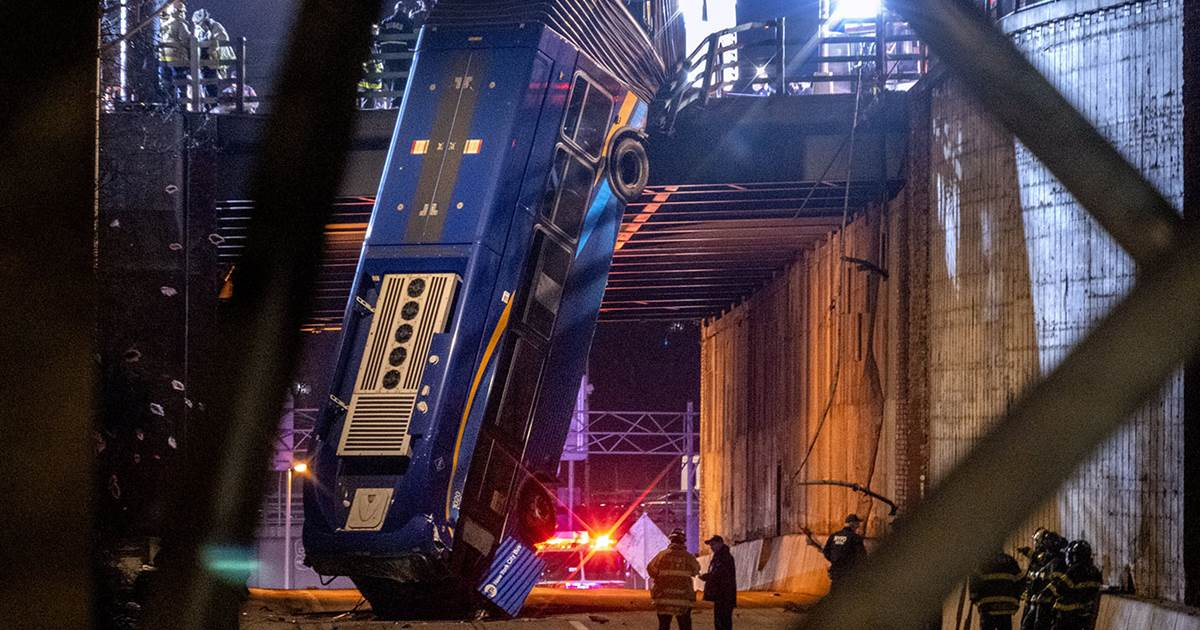 New York City bus left hanging from overpass after crash, injuring 8