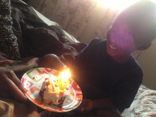 Dami with Birthday Cake in Bed
